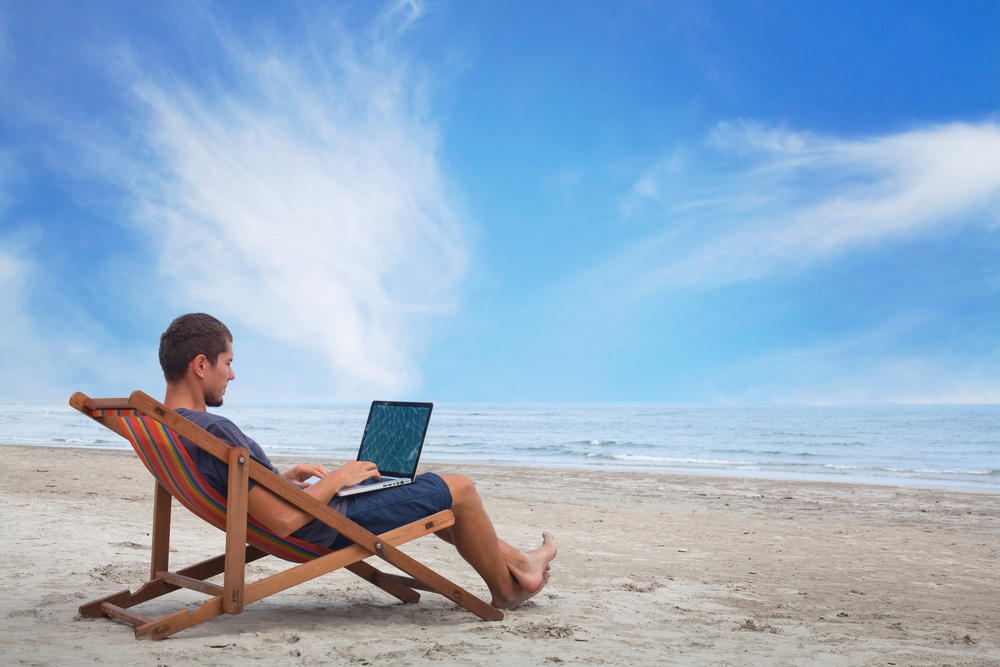 working-on-beach-withcomputer